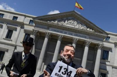 Activists stage a protest in Madrid against Spain's worsening financial crisis Photograph: Dani Pozo/AFP/Getty