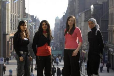 From left, Roza Salih, Agnesa Murselaj, Emma Clifford and Amal Azzudin were part of the Glasgow Girls group while still at school, brought together to take action after a dawn raid on the home of a schoolfriend's family