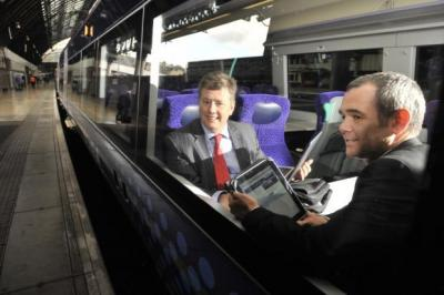 On TRACK: Transport Minister Keith Brown and ScotRail deputy managing director Kenny McPhail surf the web as they launch a wi-fi pilot on a train. Picture: Jamie Simpson