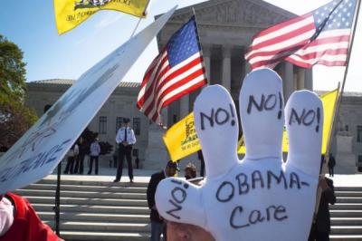 A Tea Party supporter protests over the constitutionality of the Affordable Care Act, which has already been defeated in public opinion polls.   Photograph: AFP/Getty