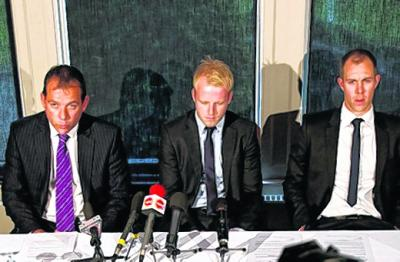 Solicitor Simon Catto with Steven Naismith, centre, and Steven Whitaker at yesterday's press conference at a Glasgow Hotel. Picture: SNS