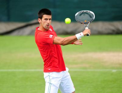 Novak Djokovic hard at work on the practice courts yesterday