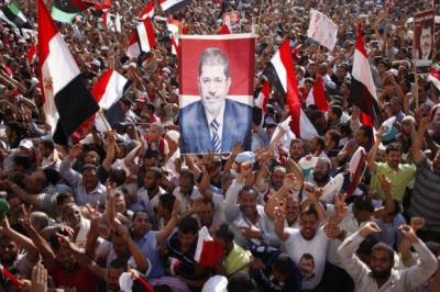 Supporters of Mohamed Morsy in celebrate Tahrir Square yesterday.
