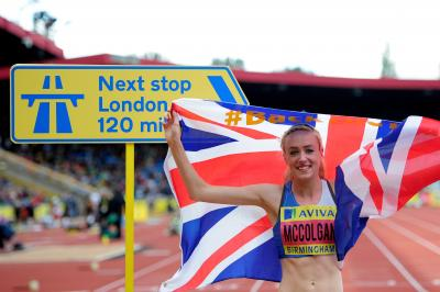 The sign says it all . . . Eilish McColgan celebrates victory in the 3000m steeplechase at the Olympic Trials. Picture: Jamie McDonald/Getty