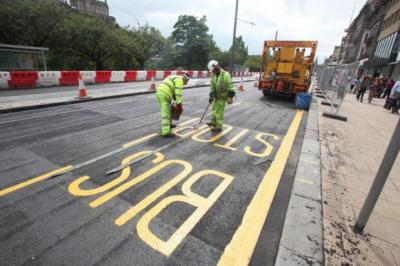 BACK TO  BUSINESS: Workmen put the finishing touches on Princes Street before it is reopened following completion of work on tram lines. However, work at nearby York Place will mean the capital's main bus station will have to be relocated for more than a year.  Main picture: Gordon Terris