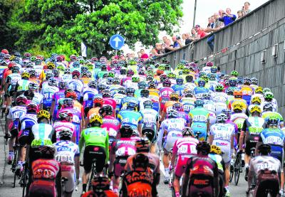 Kaleidoscopic scenes as the peloton makes its way through Liege yesterday