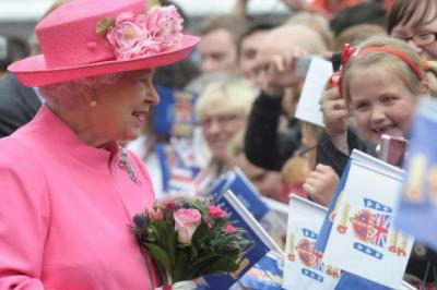 REIGN OR SHINE: The Queen meets crowds in George Square, which was turned into a sea of red, white and blue. Main picture: Kirsty Anderson