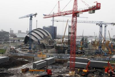 HARD TIMES: Work continues on the Scottish Hydro Arena in Glasgow but, in general, construction work is slowing. Picture: Mark Gibson