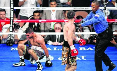 Amir Khan struggles to get off the canvas after being knocked down by Danny Garcia. Picture: Reuters