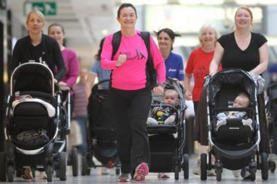 PUSHING THEMSELVES: The Buggy Buddies group warms up in Braehead Shopping Centre before heading to a nearby park for lunges, squats, press-ups then jogging back.