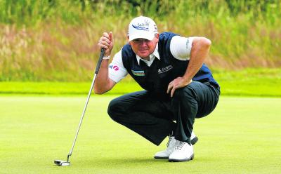 Paul Lawrie enjoyed an impressive round yesterday, albeit one which was brought to a temporary halt by Matt Kuchar. Picture: Reuters