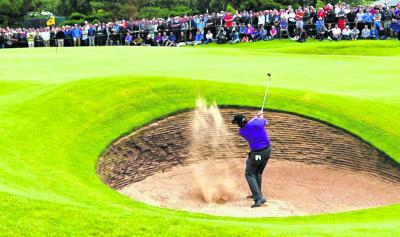 Phil Mickelson  plays out of a  bunker at the revamped sixth. Picture: Reuters