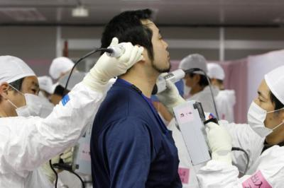 A worker is screened for radiation exposure at the Tokyo Electric Power nuclear plant at Fukushima