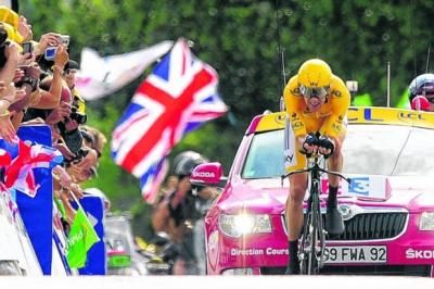 Bradley Wiggins crosses the finish line yesterday   Photograph: Reuters