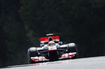 Lewis Hamilton on his way to pole   Photograph: Reuters