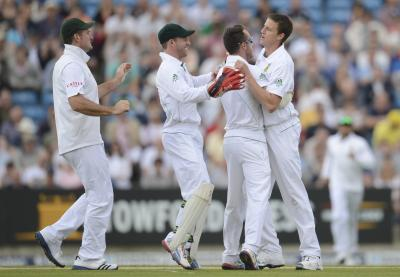 South Africa's Morne Morkel, right, is congratulated after dismissing Kevin Pietersen at Headingley. Picture:Reuters