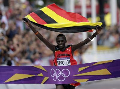Stephen Kiprotich crosses the line in The Mall