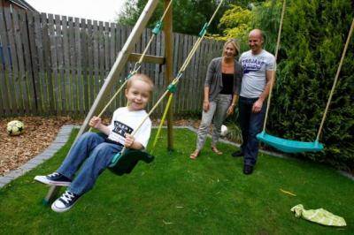 DESPAIR: Ryan was diagnosed with acute myeloid leukaemia last year. SWING OF THINGS: Ryan Ferguson with father Stuart and mother Paula at their home in East Kilbride. Picture: Martin Shields