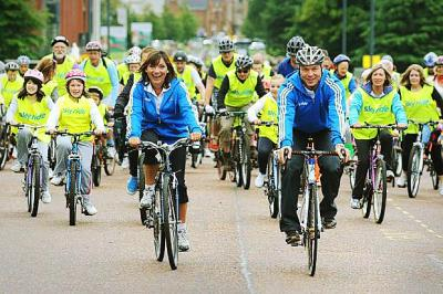 PEDAL POWER: Sir Chris Hoy joined Lorraine Kelly at the Sky Ride event in Glasgow in 2010, and will appear in his home city of Edinburgh next month. Picture: Nick Ponty