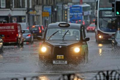 MAKING A SPLASH: The heavy rain brought disruption to Edinburgh yesterday.