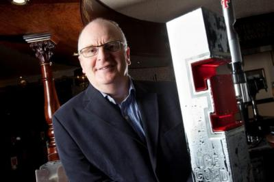 CHEERS: John Gilligan has become managing director of Tennent Caledonian Breweries in the shake-up. Picture: Chris James