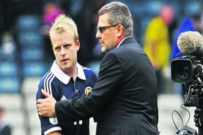 Craig Levein consoles a frustrated Steven Naismith at the end of the 0-0 draw   Photograph: Stewart Attwood