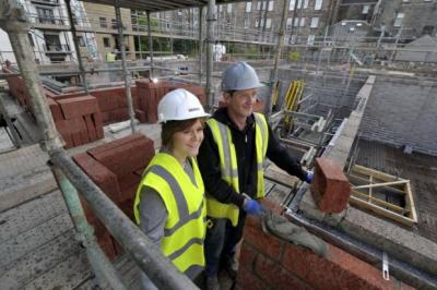 BUILDING BLOCKS: Infrastructure Secretary Nicola Sturgeon on a building site as part of the Government's scheme. Picture: Donald MacLeod