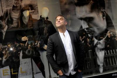 SUITS YOU SIR: Hundreds turned out to see Robbie Williams launch his menswear range 'Farrell' in Glasgow. Picture: Kirsty Anderson