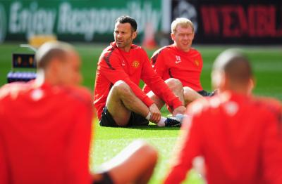 Veterans Paul Scholes and Ryan Giggs are still significant figures in the Manchester United team
