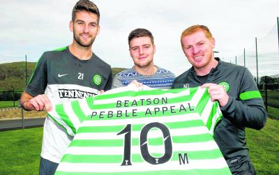 Celtic manager Neil Lennon, defender Charlie Mulgrew, left, and Jonathan Burns, son of Celtic legend Tommy Burns, promote  the Beatson Pebble Appeal at Lennoxtown yesterday. Picture: SNS