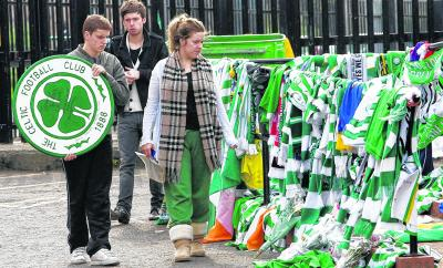 Jonathan, Michael and Jenna Burns at Celtic Park after the death of their father. Picture: SNS