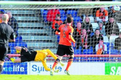 Richie Foran curls his shot past Radoslaw Cierzniak for Inverness's opener
