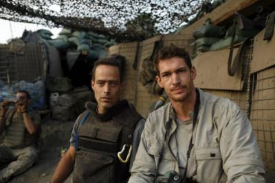 Above, Liberian rebels ahead of an attack. Tim Hetherington spent months with the group. Left, Sebastian Junger (left) and Hetherington on assignment at the Restrepo outpostMain picture: Tim Hetherington
