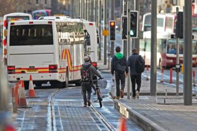 ENFORCEMENT: The number of fines issued to cyclists in Edinburgh, who now have city centre tram lines to contend with, has almost doubled since 2010. Picture: Gordon Terris