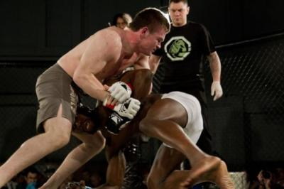 Scottish MMA star Alan 'AJ' Johnston wrestles Ousmane Sidibe for position at On Top 4 in Glasgow