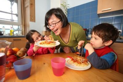 CHEWING IT OVER: Ivonne Hughes serves her children Iliana and Oscar the same dishes as her and her husband Joseph. Picture: Martin Shields