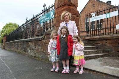 CHOICES: College lecturer Julie Wales, with daughters Orlaith, Xanthe, and Lorelei, needs to use placing requests for a Glasgow south-side school to be able to continue with her job.