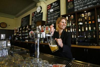 WEST GOES EAST: The company's Petra Wetzel pours a pint in the company's existing brewery near to Glasgow Green. Picture: Martin Shields