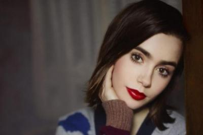CHIC: Actress Lily Collins, daughter of Phil Collins, models the knitwear firm's collection. Picture: Karl Lagerfeld