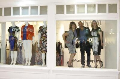 Susan Milne from Giffnock in an outfit at the Marisota pop-up shop in the Buchanan Galleries. Top, in the shop window are  models Jane Russell, left, and Debbie Flett with designer Mark Heyes   Photographs: Martin Shields