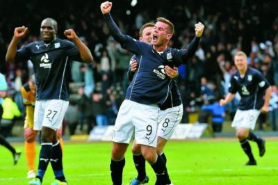 Peter MacDonald celebrates after scoring the goal that put Dundee 2-0 in front at Dens Park Photograph: SNS
