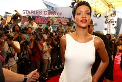 Rihanna softened her image with a white draped, Grecian style gown and pixie crop