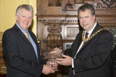 Russell Shepherd receives Queen's Award from Lord Provost Donald Wilson