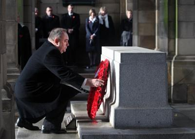 First Minister Alex Salmond lays a wreath during Scotland's national ceremony at the Stone of Remembrance