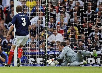 Paul Dixon watches as Allan MacGregor pulls off a save