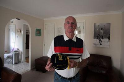 Neil Martin proudly shows off a Scotland cap