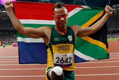 Oscar Pistorius celebrates after winning the gold medal in the T44 400m at the Paralympics 2012