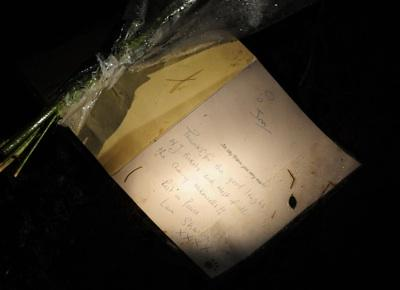 An old message and flowers left at the grave